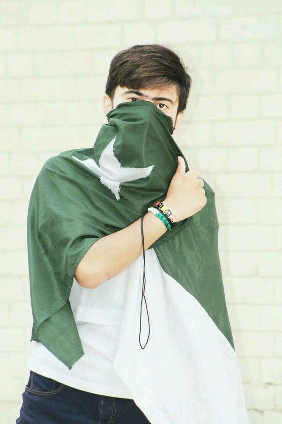 boy with pakistani flag on face defence day profile picture